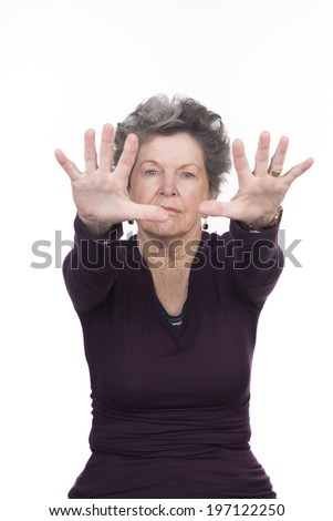 elderly woman doing exercise in studio on a white background