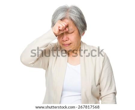 Elderly woman feel headache - stock photo