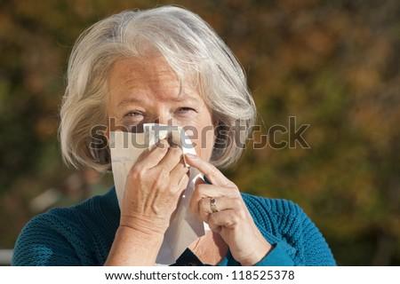Elderly woman has flu - stock photo