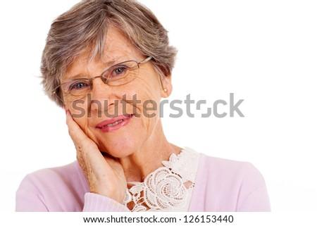 elderly woman headshot over white background - stock photo