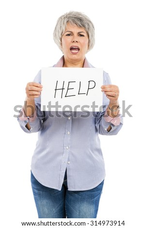 Elderly woman holding a paper card asking for help