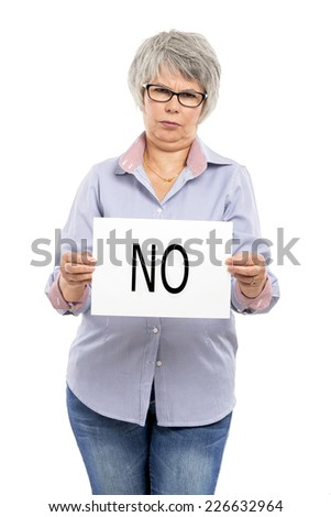 Elderly woman holding a paper card  with the word No - stock photo