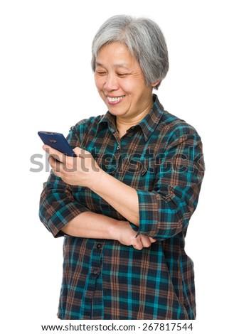Elderly woman look at smartphone - stock photo
