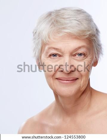Elderly woman on white background - stock photo