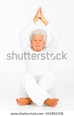 elderly woman practicing yoga - stock photo