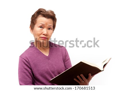 Elderly woman read a book.
