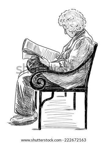 elderly woman reading a newspaper
