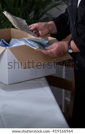 Elderly woman readnig letters from an old lover - stock photo