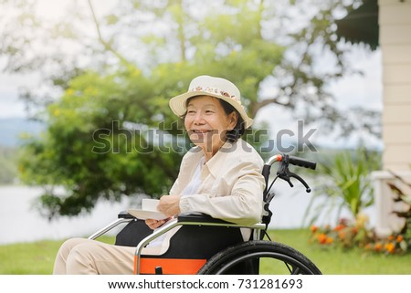 elderly woman relax in backyard