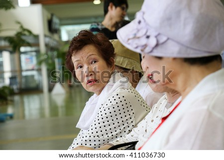 Elderly woman sitting