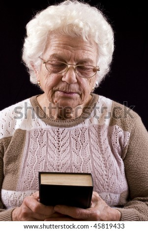 Elderly woman studying the Bible