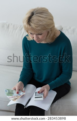 Elderly woman trying to solve her financial problems