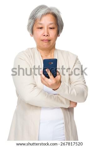 Elderly woman use of cellphone - stock photo