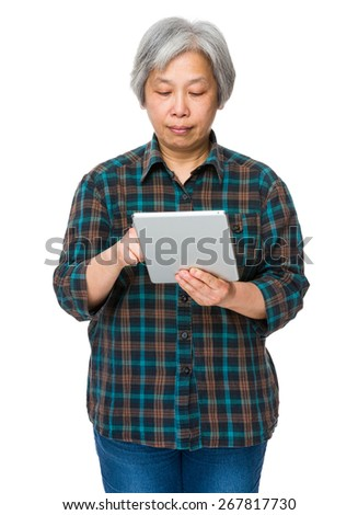 Elderly woman use of tablet - stock photo