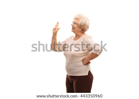 Elderly woman waving to someone with her hand isolated on white background - stock photo