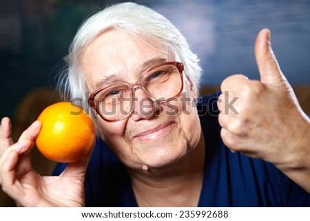 Elderly woman with fruits. Healthy diet and nutrition. - stock photo