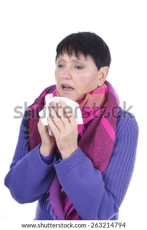 Elderly woman with handkerchief and cold isolated - stock photo