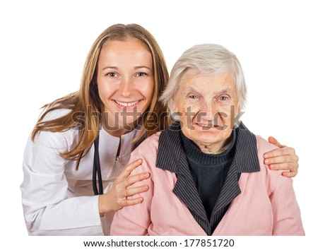 Elderly woman with her helpful medical assistant - stock photo