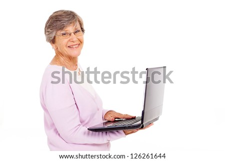 elderly woman with laptop computer isolated on white - stock photo