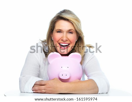 Elderly woman with piggy bank. Isolated over white. - stock photo