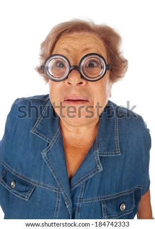 Elderly woman with surprised expression with funny eyeglasses on white background.