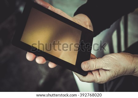 Elderly woman with tablet computer. Senior people using internet. TONED IMAGE. - stock photo