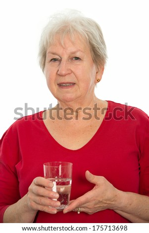 elderly woman with water glass - stock photo