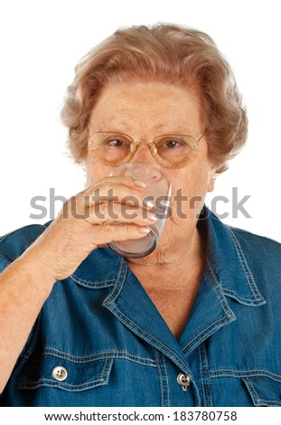 Elderly woman with water glass on white background - stock photo