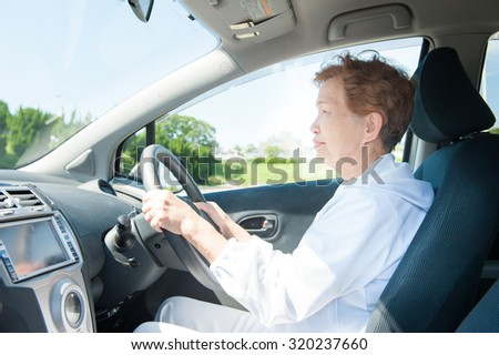 Elderly women who are driving a car