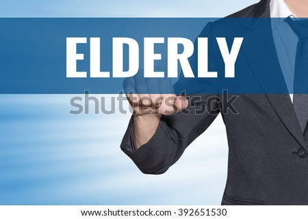 Elderly word Business man touching on blue virtual screen - stock photo