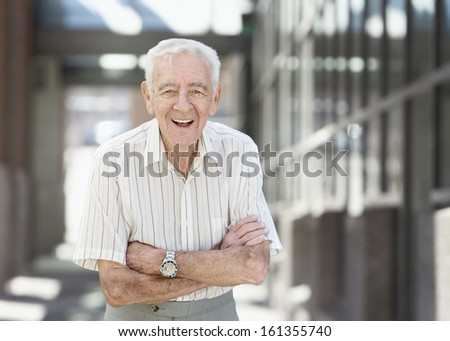 Elderly 90 year old man laughing healthy businessman  - stock photo