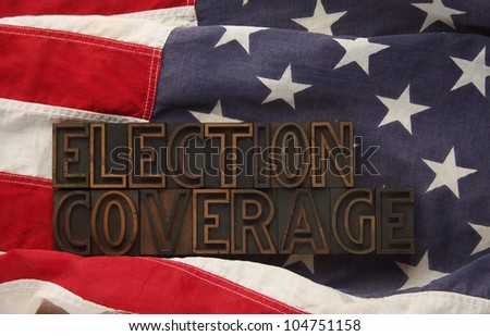 election coverage words in old wood type on a USA flag - stock photo