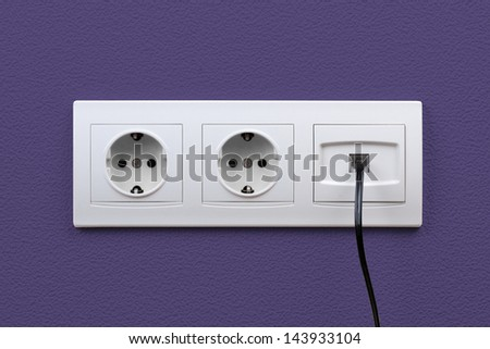 Electric and internet outlets on wall, electric cable and internet