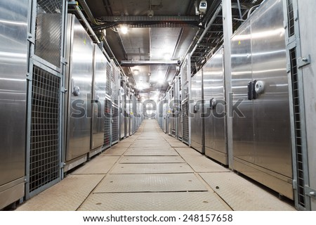 electric boxes corridor - stock photo