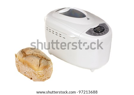 Electric bread maker and one fresh bread isolated on a white background - stock photo