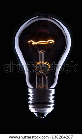 Electric bulb lamp with a spiral on a black background