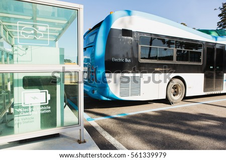 Electric bus stands at the charger. Alternative sources of fuel