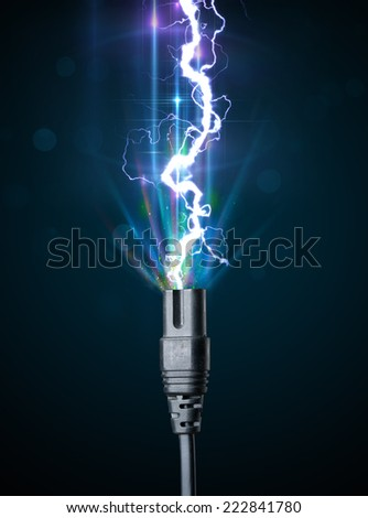Electric cable close-up with glowing electricity lightning - stock photo