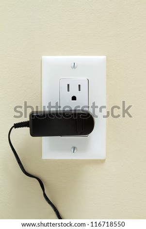 Electric cable in Electrical Outlet on the Wall. Power 110v - stock photo