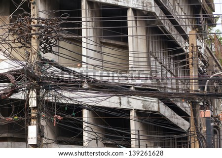 Electric cable mess in Bangkok, Thailand - stock photo