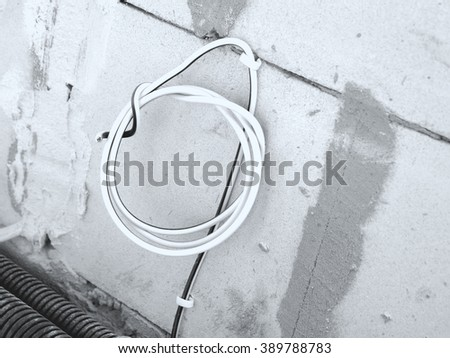 Electric cable on the wall
