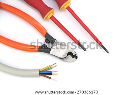 Electric cable with tools on a white background. - stock photo
