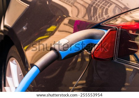 electric car connected to the charger - stock photo