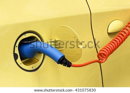 Electric car in charging station  - stock photo