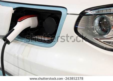 electric car is charging new technology - stock photo