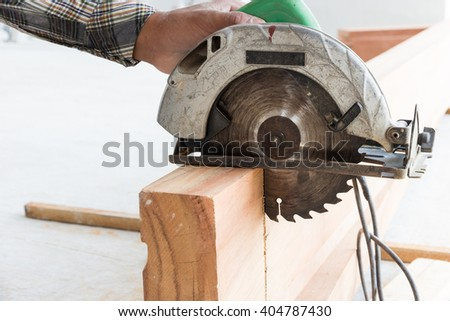 Electric circular saw in construction buil wood staircase