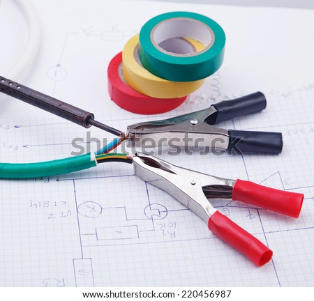 Electric clamps and adhesive plastic tape  on a background of the electric scheme