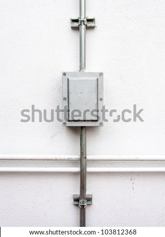 Electric control box on the white wall of factory. - stock photo