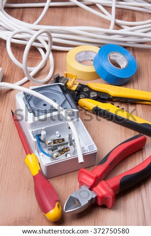 Electric devices and accessories during cables and fuses instalation - stock photo