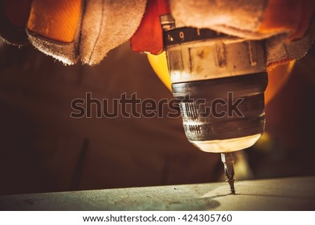 Electric Drill and Screw. Small Construction Works Closeup Photo. - stock photo